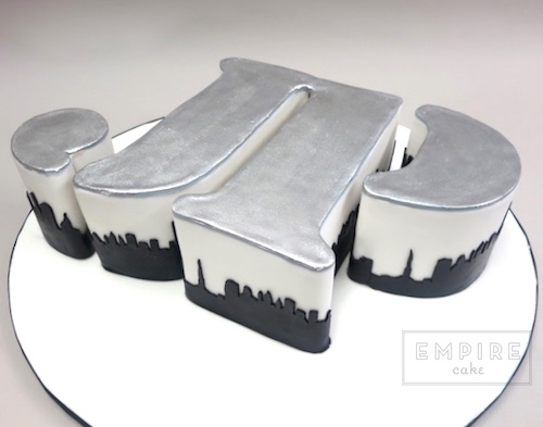 Sculpted Initials with Cityscape