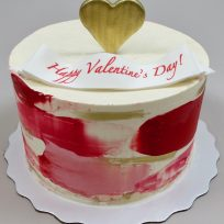 Watercolor buttercream with gold heart topper