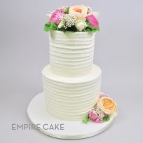 Textured Buttercream with Magenta and Orange Ranunculus